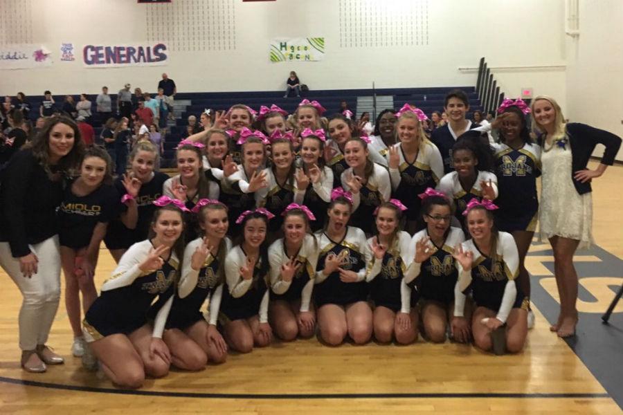 Midlo cheerleaders celebrate their win.
