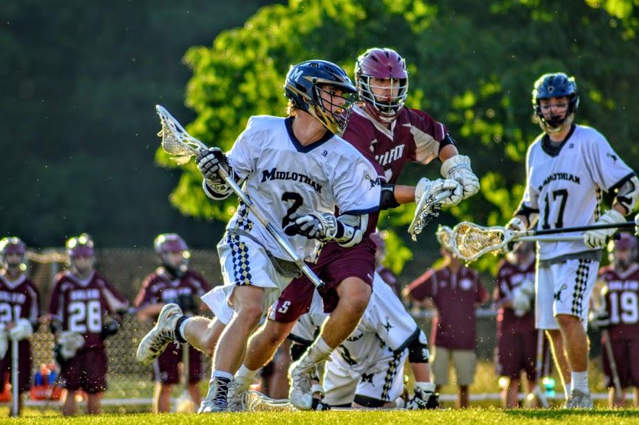 Dillon+Powell+carries+the+ball+towards+the+goal.