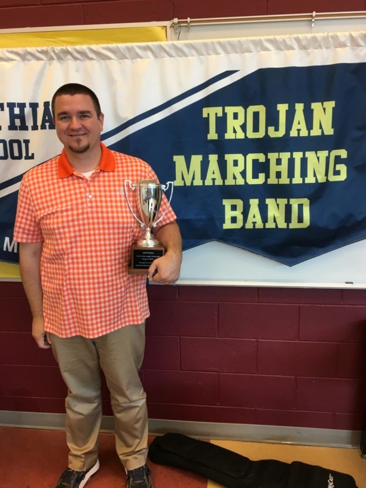 Mr.+Gordon+Rawls+received+the+Teachers+Recognizing+Teachers+award+from+Mr.+Chris+Eliot+for+his+dedication+to+his+students+and+Midlo%27s+music+program.