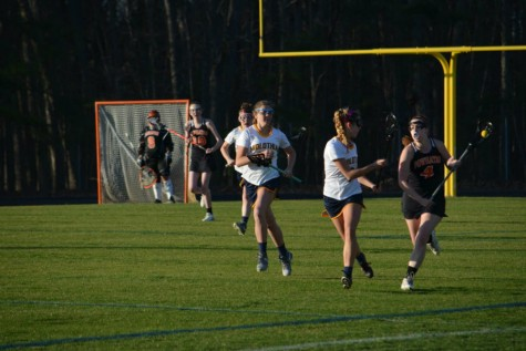Up for a Toss with Girls Lacrosse