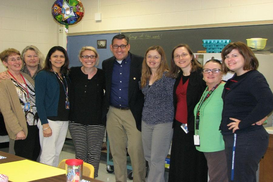 Members+of+Midlo%27s+World+Language+Department+congratulate+Mr.+Rob+Gifford+on+his+honor.