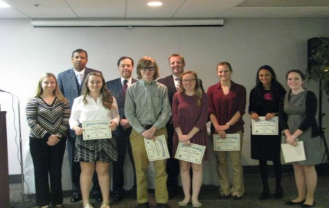 Midlothian students Malia Wing, Austin Van Horn, Madeline Dutton, Amber Arnold, Neha Kulkarni, and Kimberly Russell hold up their certificates and stand by Principal Shawn Abel, sponsor Mrs. Warriner, CCPS superintendent Dr. Marcus Newsome, and County Administrator Mr. Jay Stegmaier.