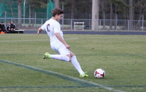 Michael South clears the ball out of the back.
