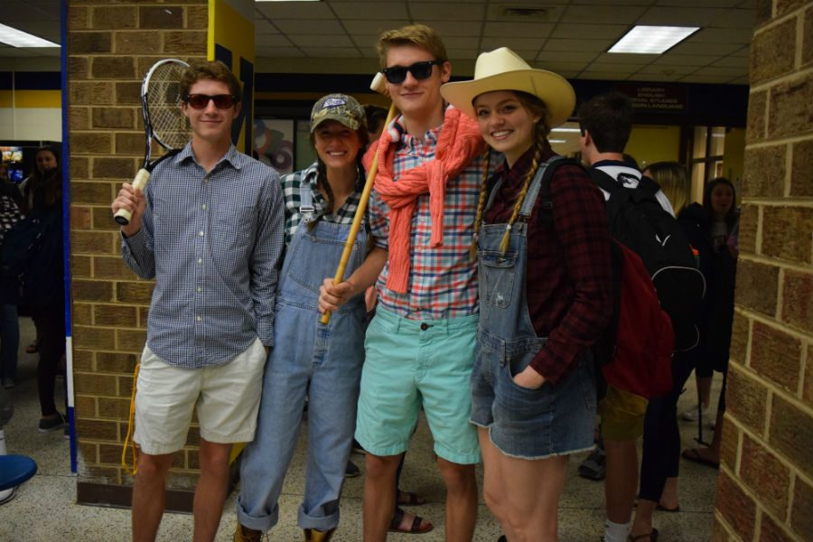 Tanner, Ally, Nick, and Mada proudly wear their spirit wear for Country Club vs. Country Day in the open commons.