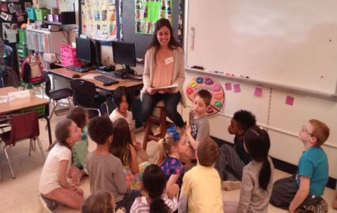 Bella Urcia reads children's stories to her younger students.