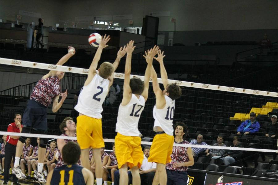 Nick Spichiger, Carter Fulghum, Austin Power, goes up for a triple block