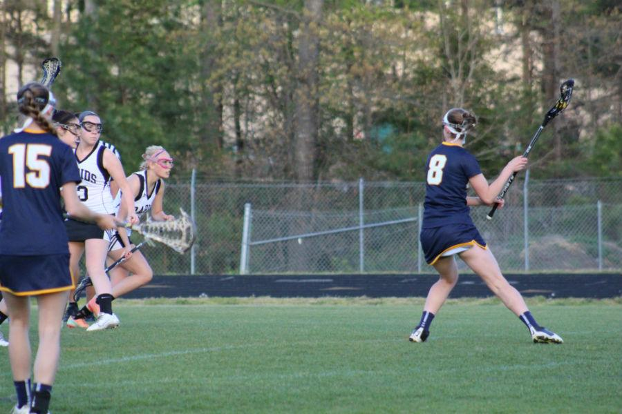 Star player, Natalie Webster winds herself up and prepares to score on the James River goalie.