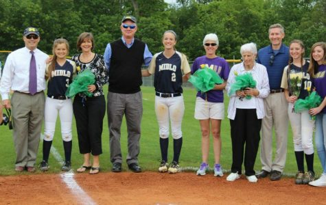 The Softball seniors including Annah Walsh, Ally Smith, and Emily Aurelius pose with their families for a group photo.
