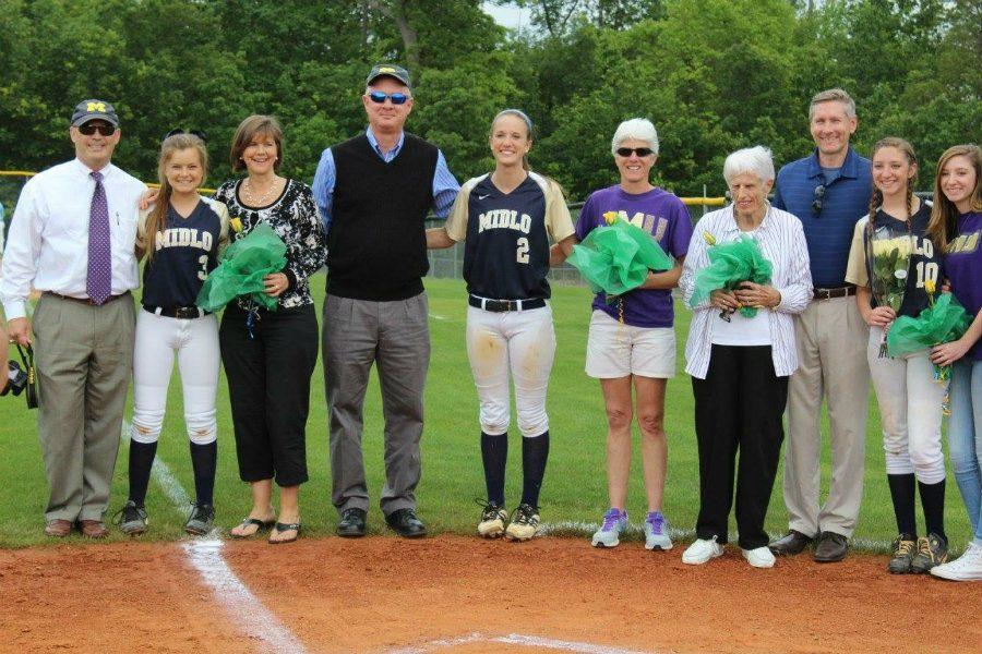 The+Softball+seniors+including+Annah+Walsh%2C+Ally+Smith%2C+and+Emily+Aurelius+pose+with+their+families+for+a+group+photo.+