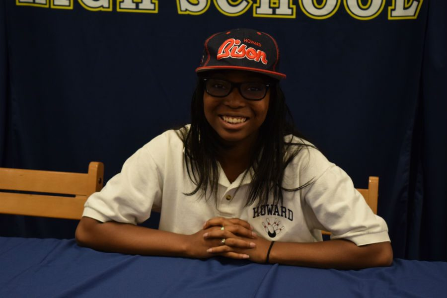 Téa Lewis smiles proudly after officially signing to bowl at Howard University next year.