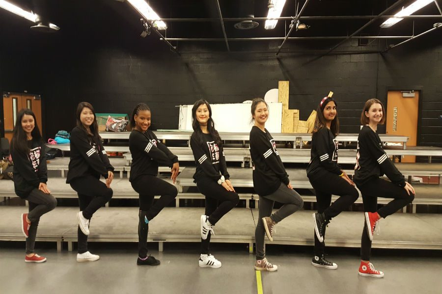 Midlo+KPOP+dancers+strike+a+pose+while+practicing.