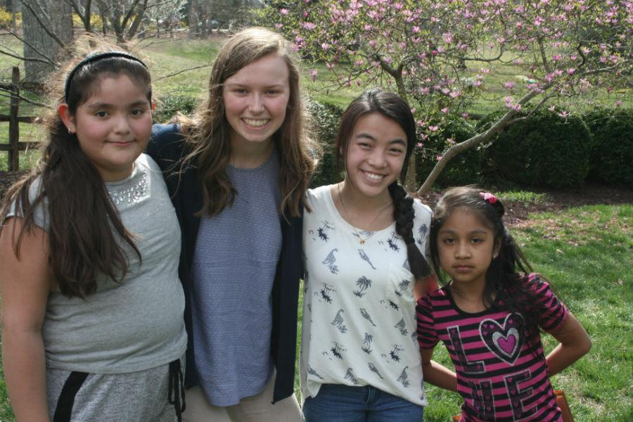 Phoebe and Chloe smile with their kids during the Easter Egg Hunt. Apply to become a Homework Helper today!