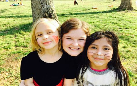 Lilly and her two kids are all smiles at the annual Homework Helpers Easter Egg Hunt