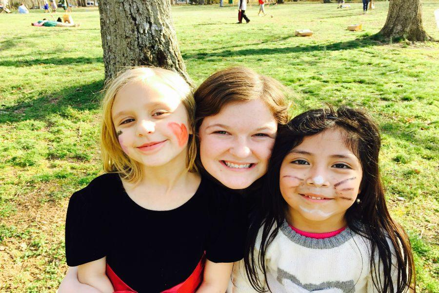 Lilly+and+her+two+kids+are+all+smiles+at+the+annual+Homework+Helpers+Easter+Egg+Hunt