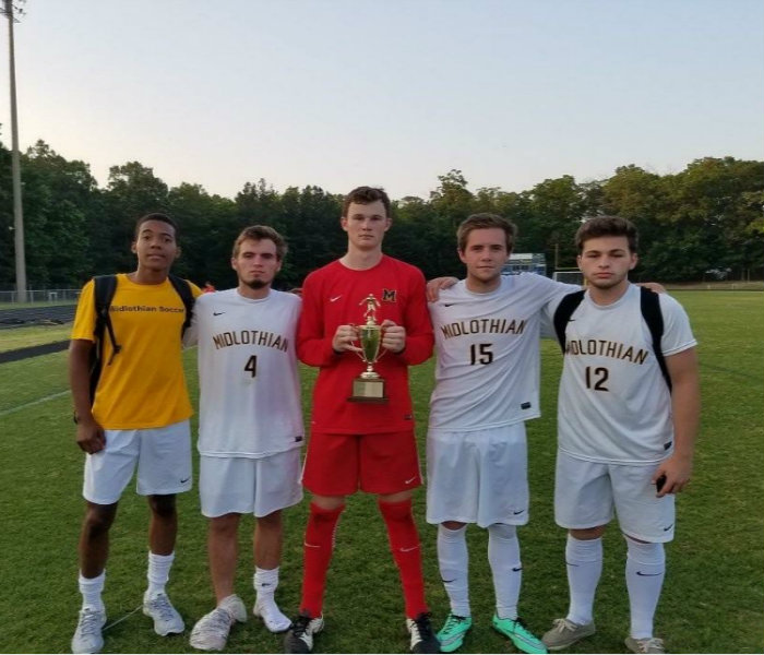 Ian+Connor%2C+Taylor+Vest%2C+Connor+Rea%2C+Noah+Dubiel%2C+and+Erick+McNeil+represent+their+teammates+as+they+celebrate+winning+the+4A+Conference+20+Championship.