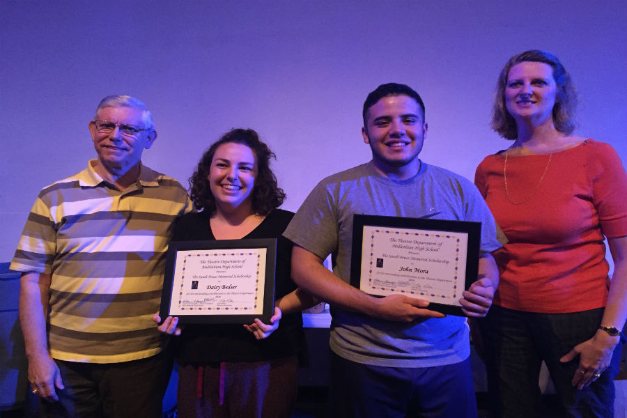 John Mora and Daisy Bedser hold up their scholarships standing next to Butch Eudailey and Mrs. Miller