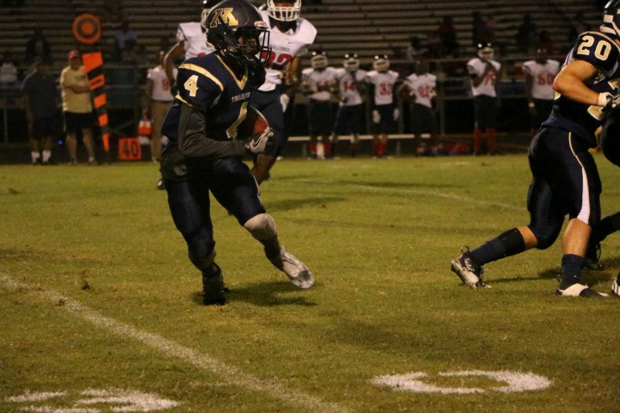 Jermani Brown catches the ball and makes a break down the field.