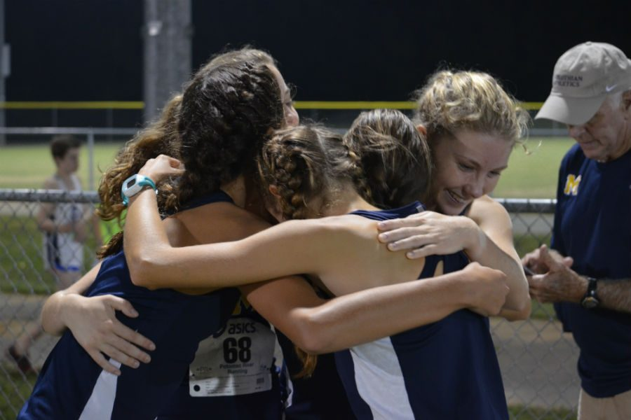 The+Varsity+girls+join+in+for+a+big+hug+after+their+race.