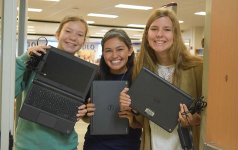 (left to right) Sophia Kopidis, Bella Urcia, and Ellen Tucker excitedly show off their Chromebooks.