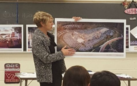 Mrs. Karen Smith explains the renovation of the Stony Point Fashion Park Mall. to Mrs. Manheim's IB Business Management class.