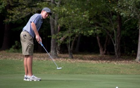 Kyle Clarke swings his putter at the Regional Golf Tounament.