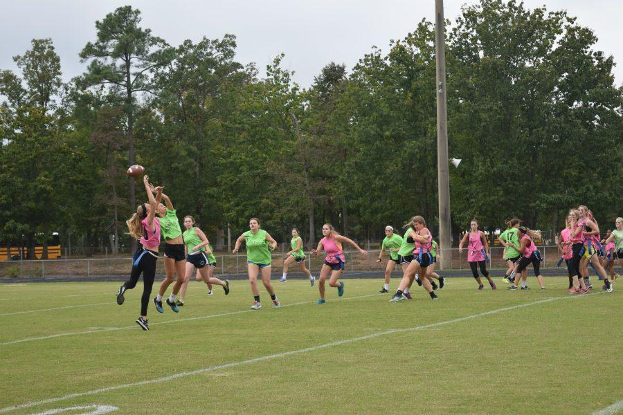 Seniors and Juniors jump for the football.