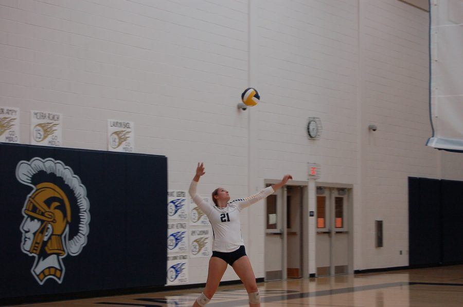Rachel+Trebor+winds+up+to+pound+the+serve+against+Powhatan