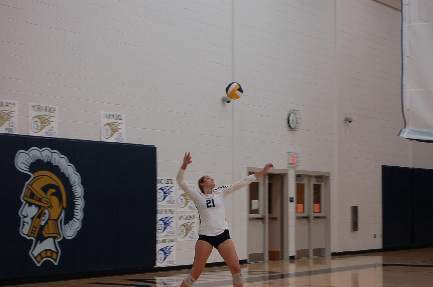 Rachel Trebor winds up to pound the serve against Powhatan