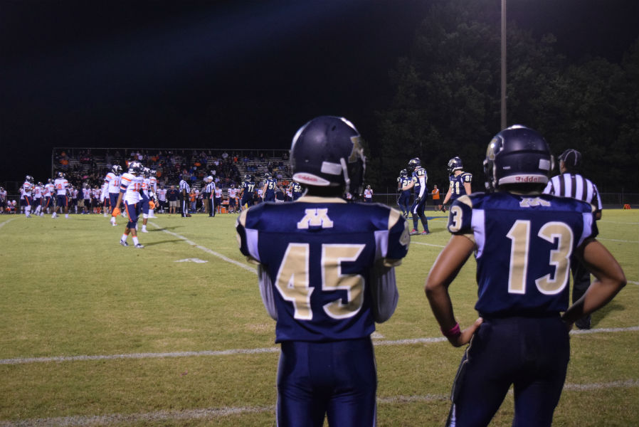 Jaron Walker #45 and Ivan Jackson #13 communicate their offensive strategy on the sideline.