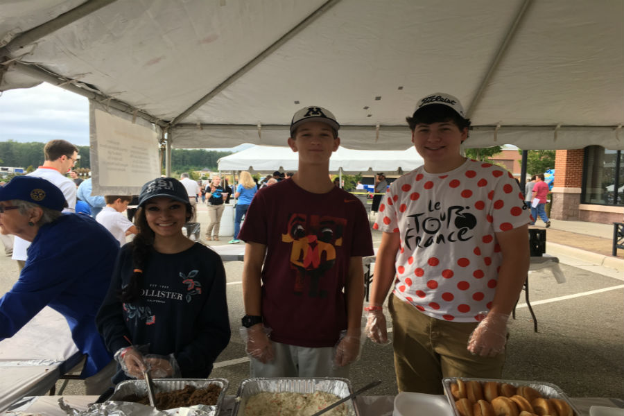 Midlothian juniors, Luke Manheim and Ryan Klaiber, work the barbecue stand at the Magnificent Midlothian Food Festival.