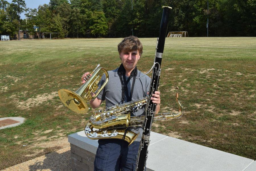 Matthew Tignor stands with his arsenal of instrumentation.