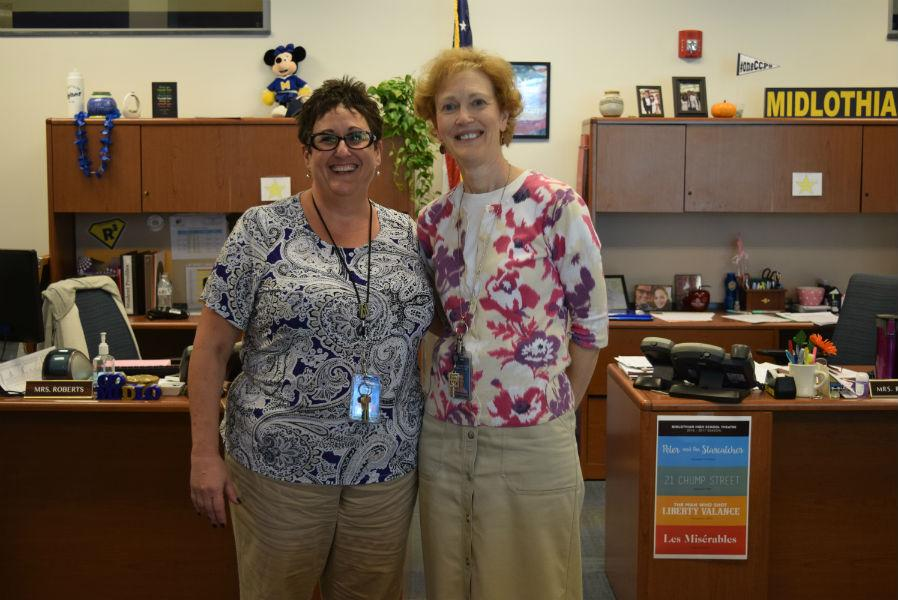 Mrs. Roberts and Mrs. Reynolds hold down the fort in the Midlo front office.