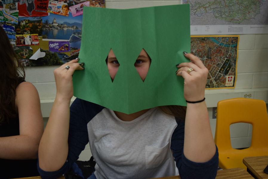 Tori-Anna Hamilton peeking through, ready to cut out more shapes