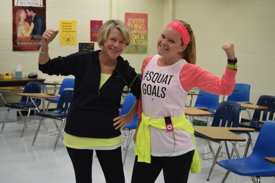 Mrs. Tucker and Mrs. Palenski show their muscles on Workout Wednesday.