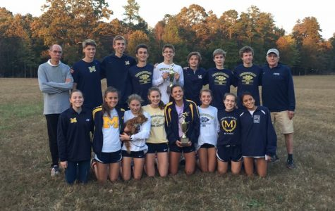 The Midlothian Cross Country team celebrates their big win.