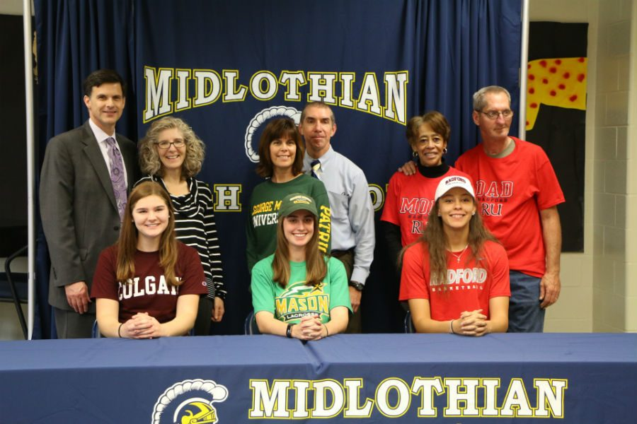Nora+Mulroy%2C+Natalie+Webster%2C+and+Tina+Lindenfeld%2C+accompanied+by+their+parents%2C+signed+their+letters+of+intent+to+play+collegiate+sports+next+year.+