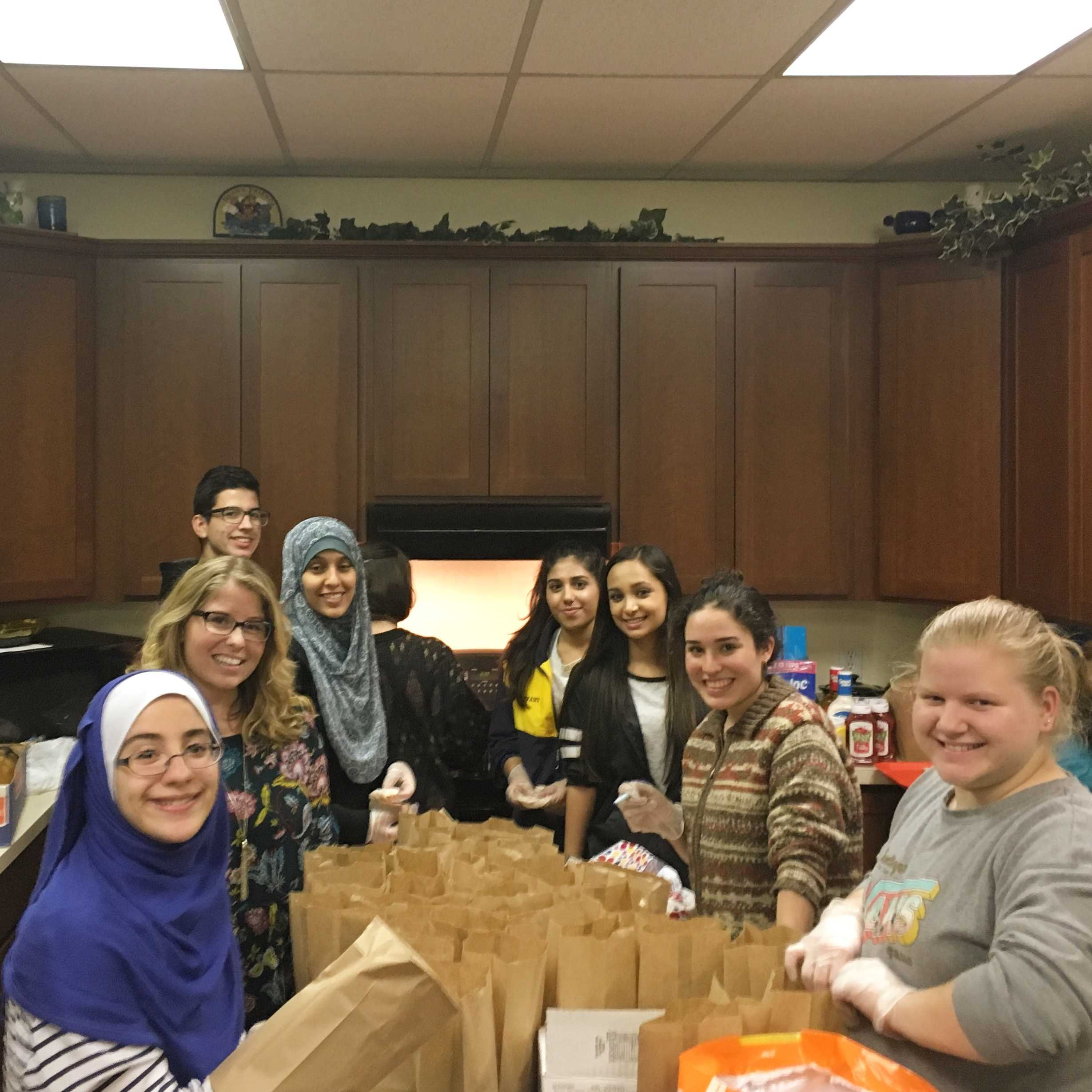 Members of Midlo's World Religion and Tolerance Society, along with their sponsor, Ms. Brooke Rekito, volunteer to benefit CARITAS.
