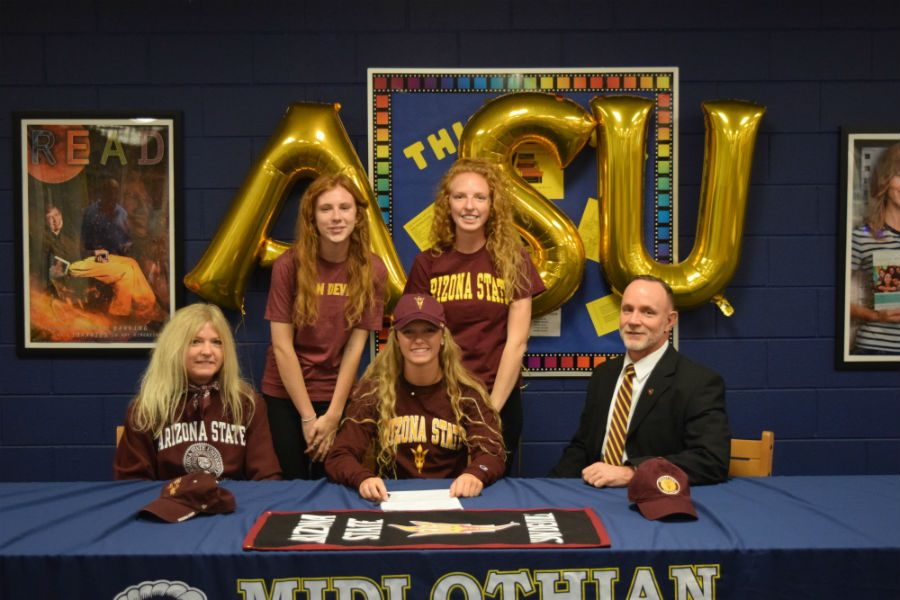 Senior+Camryn+Curry+celebrates+with+her+family+as+she+signs+to+swim+Arizona+State.
