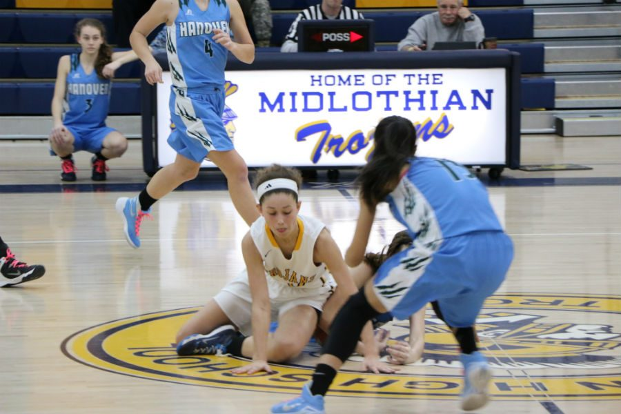 Senior McKenna Steele and the Midlothian Trojan girls have to fight hard to win this season.