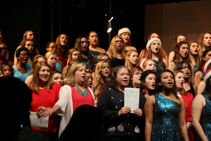 Midlo+faculty+joins+the+choral+groups+for+the+finale.