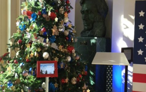 A huge bust of Lincoln sits behind one of the Christmas trees.