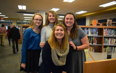 Emily Junkmann, Sydney Van Horn, and Michaela Nadeau spend time after the induction with NEHS sponsor Mrs. Hill.