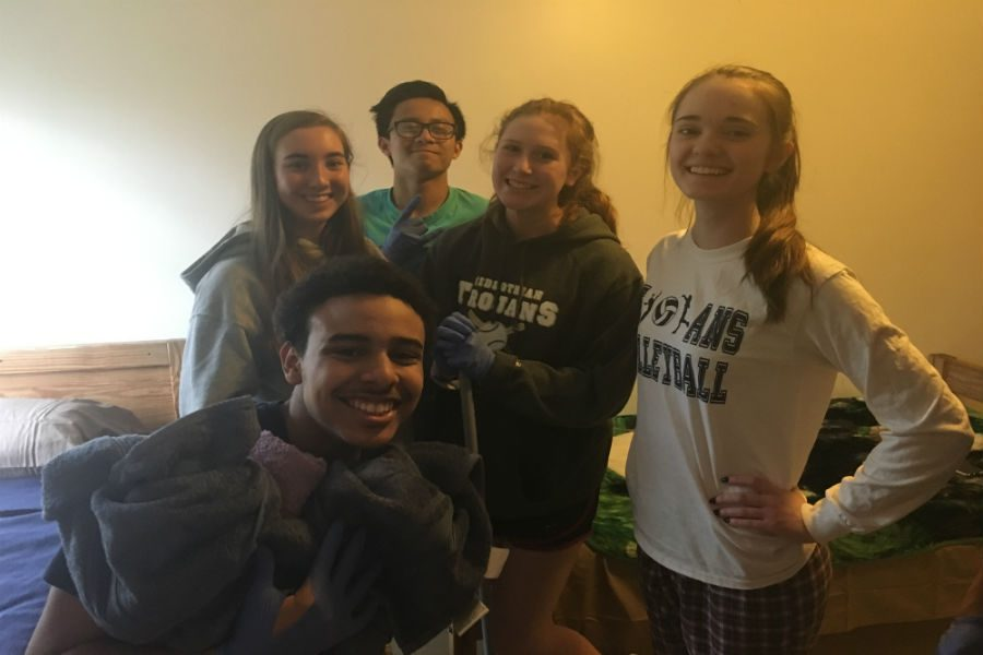 Maggie McDermott, Andre Protacio, Elizabeth Czenczek, and their friends had a great time cleaning up the Hilliard House.