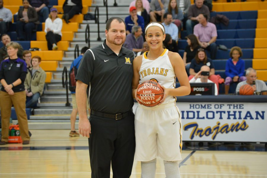 Coach Layton celebrates with Tina Lindenfield as she scores 1,000 points.