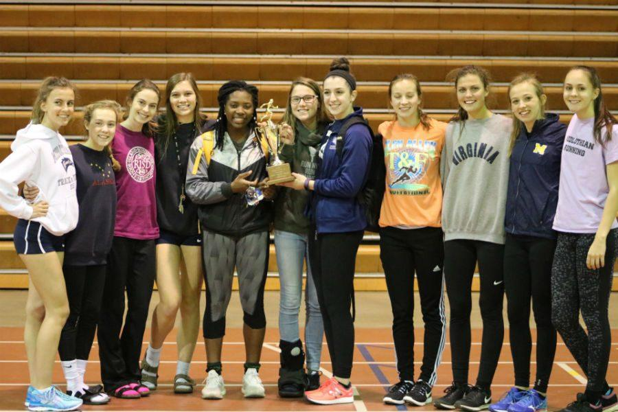 The+girls+indoor+track+team+celebrate+their+win+together.