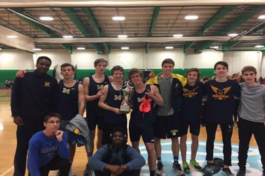 The+boys+indoor+track+team+enjoys+their+big+win.