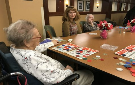 Marion Cline teaches French bingo phrases to residents  of Lexington Court Nursing Home.