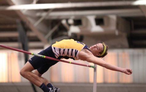 Lucas Via high jumps over the bar.