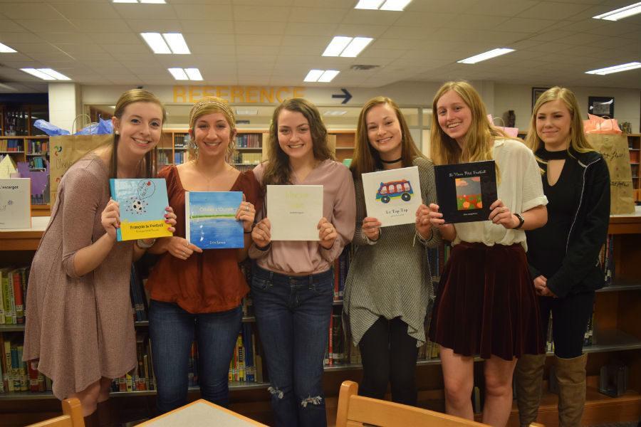 Sarah Furman, Erin Sanza, Elizabeth Ferguson, Kristen Botset, Alex Josephson, and Emily Ashman show off their books.