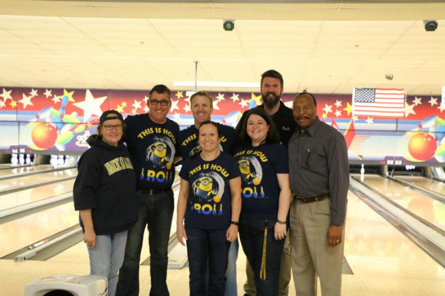Midlothian High School administrators, plus Mrs. Giles and Mr. Spewak, show how they roll.